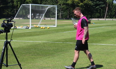 CRAIG CURRAN WALKS OFF THE TRAINING FIELD LOOKING VERY TIRED