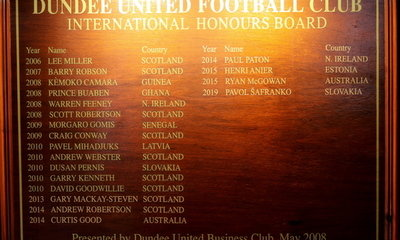 the second of the two international hours boards at tannadice shows pav's name now on it.