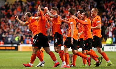 players celebrating the first goal