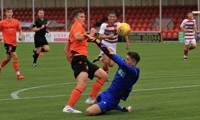 United's second goal : Adam Hutcheson chips the Keeper before going on to score. Pic Peter Rundo