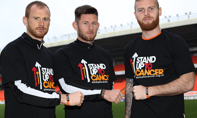 Captain Mark Reynolds, Calum Butcher and Mark Connolly showing their backing