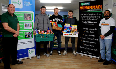 Dundee Foodbank Manager Ken Linton, together with Calum Butcher, Club Captain Mark Reynolds and Rizwan Rafik from Taught by Muhammad