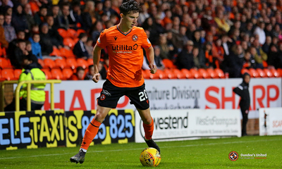 Logan with the ball at his feet on Tannadice