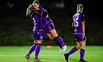 Robyn Smith celebrates with Holly Napier after she scored the last goal in the 4-1 home win over Boroughmuir Thistle.